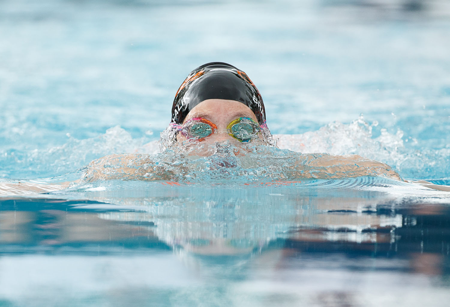 Annaliese Brady-Falik of Overlee surfaces during the girls 11-12 breaststroke. (Photo by Dave Facinoli)