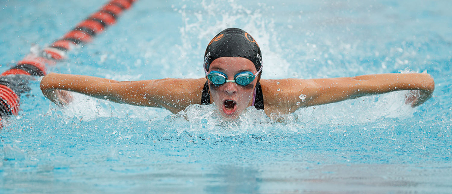 Overlee's Hannah Portner has good form and causes little splash as she swims the girls 13-14 butterfly. (Photo by Deb Kolt)