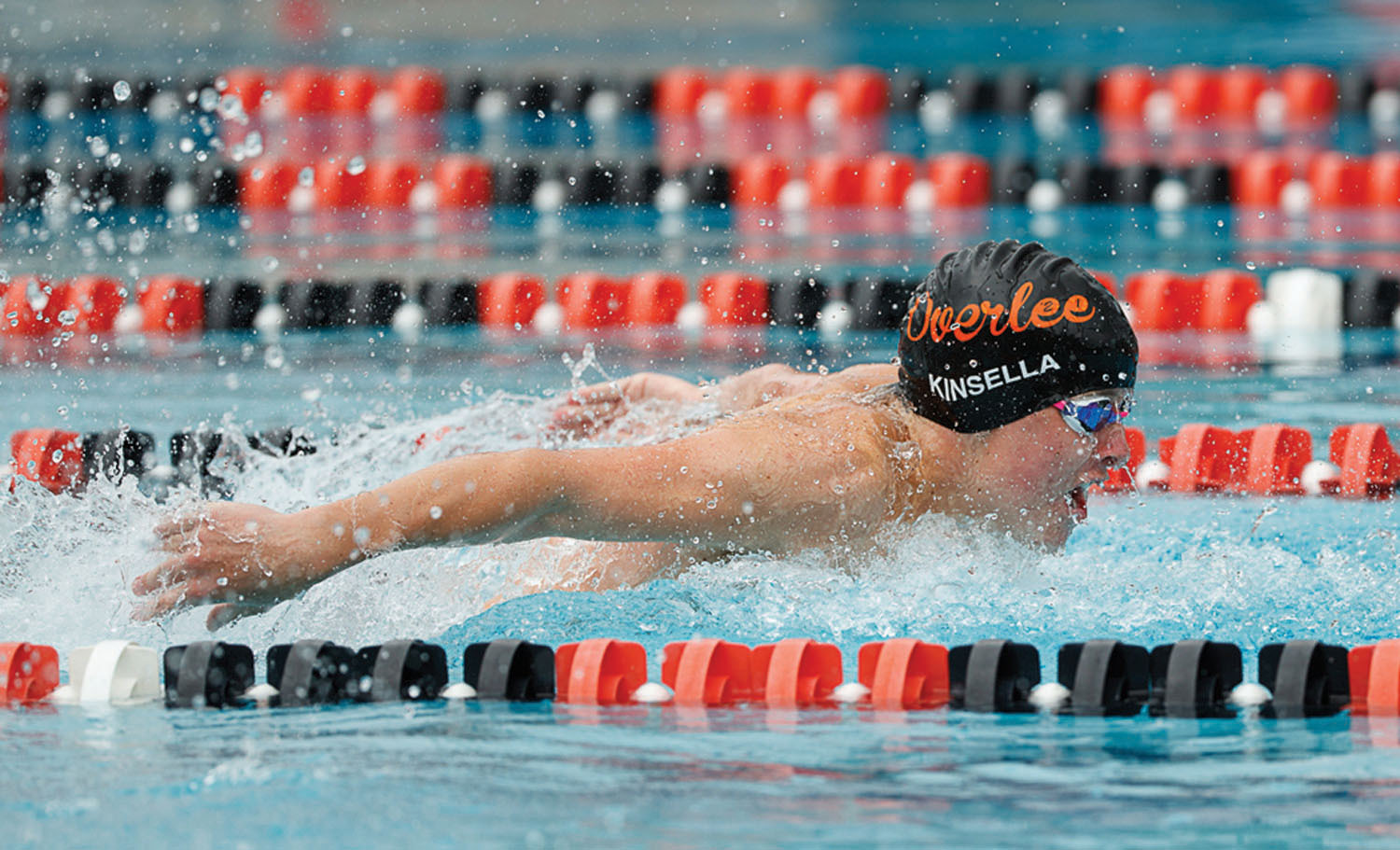Overlee's Christopher Kinsella swims the butterfly leg of the boys 15-18 medley relay. (Photo by Deb Kolt)