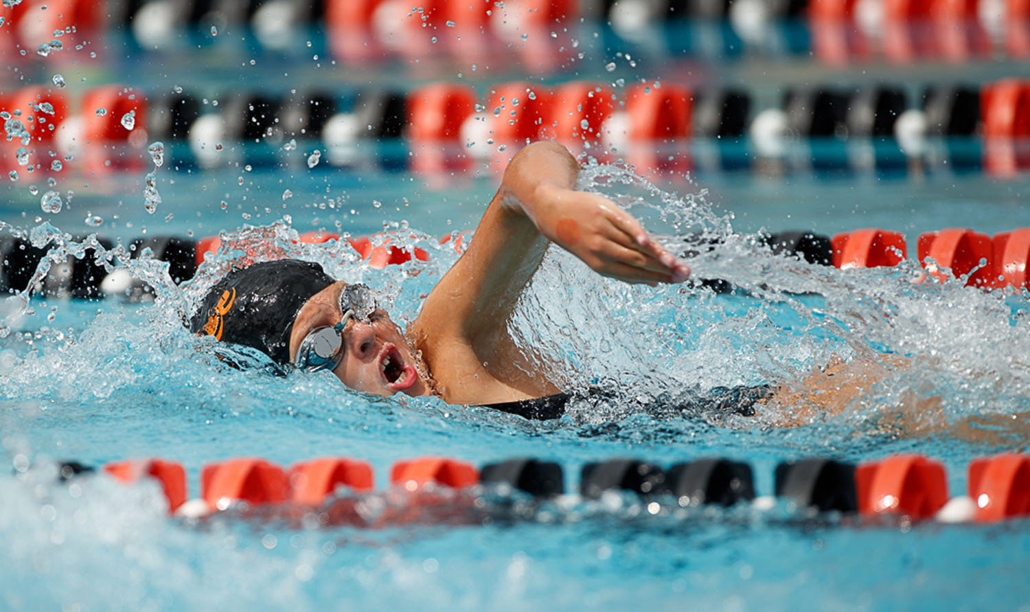 Overlee's McKinley Busen swims the girls 18-under mixed age freestyle. (Photo by Deb Kolt)