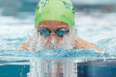 HIghlands' Rio Walther surfaces in the girls 9-10 breaststroke. (Photo by Deb Kolt)